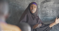 A woman talking in a classroom at an IDP camp in Somalia