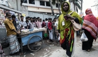 Ruksana Begum, a garment worker in Bangladesh, on her way to the factory