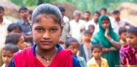 A teenage girl at a community gathering in a village near Hardoi, India