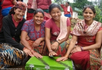 Women with the savings box in Syangja village, Nepal.
