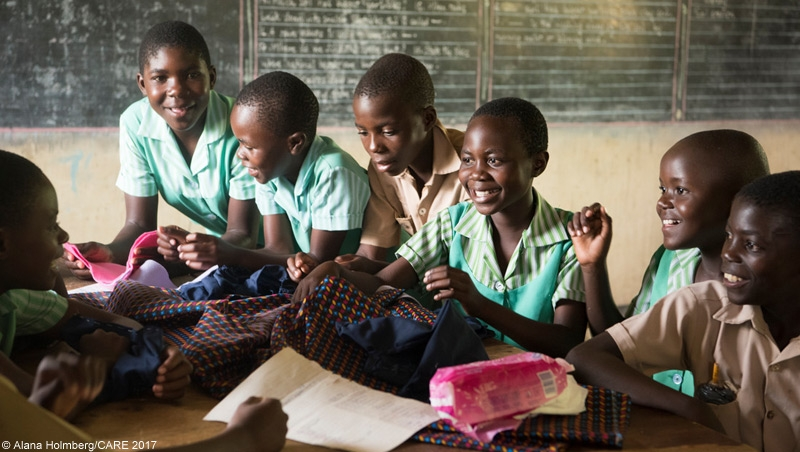 Boys and girls at school in Zimbabwe learning how to sew reusable sanitary pads.