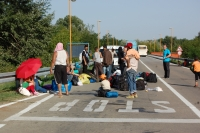 Refugees gathering by a roadside in Serbia