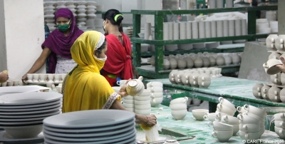 Women workers in a pottery factory in Bangladesh, part of the Living Blue collective supported by CARE