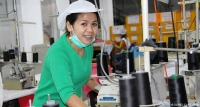 Han Lee, a garment factory worker in Laos