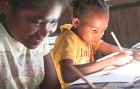 Angeline and Clarette at school in Ampaho village, Vatomandry District, Madagascar