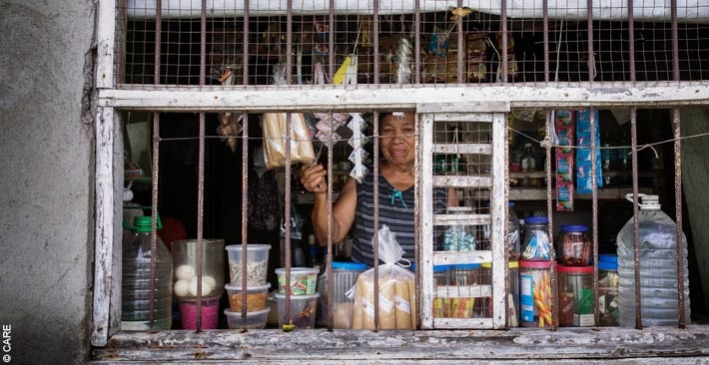 Veronica, a micro-entrepreneur in the Philippines, in her small shop from which she also runs a ginger-tea-making business