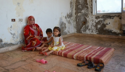 Syrian refugees living in a derelict building