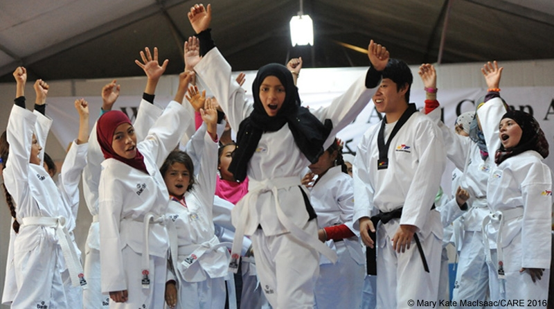 Girls from Syria take CARE-supported taekwondo class in Azraq refugee camp in Jordan