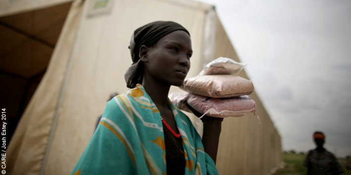 Martha Nyabar with packets of seeds distributed by CARE in South Sudan
