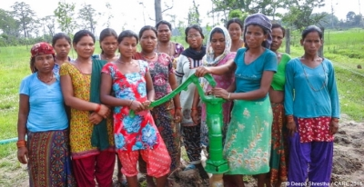 Pragatiseel CLAC women standing in front of hand pump constructed by saving lunch allowance provided to them during CLAC classes ran by the Hariyo Ban Program, CARE Nepal