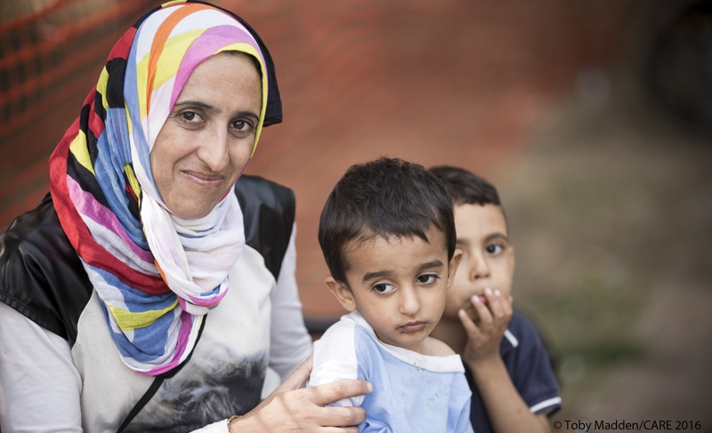 Dana (name changed) and her sons Mohammad (aged 4) and Abdulsalam (aged 2) in a park near the bus station in Belgrade, Serbia