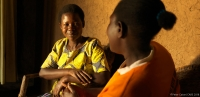 A woman talks to a facilitator regarding gender based violence (GBV) services in Rwanda