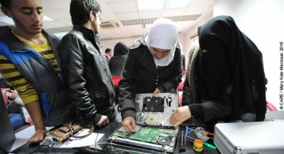 Samia (name changed), a Syrian refugee living in Jordan, is learning laptop and computer repair through a CARE vocational training programme