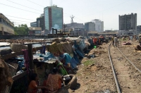 Slums and highrise office buildings in Dhaka, Bangladesh © CARE / Dan White 2006