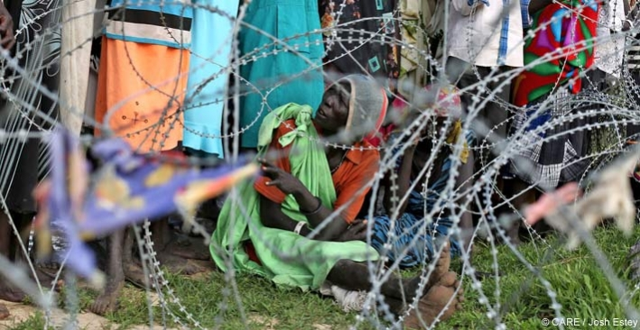 A woman queuing outside a camp for internally displaced people in South Sudan