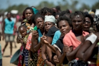 Women on the frontlines of the climate emergency queue for supplies following Cyclone Idai in Mozambique.