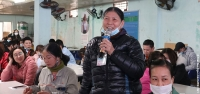 Mrs. The, a garment worker in Vietnam, speaking at a public discussion on sexual harassment in the workplace