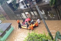 A rescue during flooding in Indonesia in January 2013. © CARE / Paul Dixon