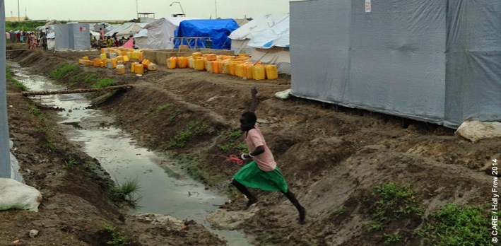A girl leaving a CARE-constructed latrine at the UN Protection of Civilians site at Malakal, South Sudan