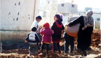 A family in Dara'a governorate in southern Syria, where CARE is working with partners to deliver emergency supplies to more than 30,000 people