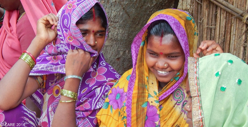 Young women in India discussing family planning methods at a CARE project