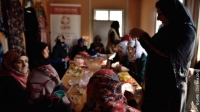 Syrian refugee women and local Jordanian women from the town of Azraq meet at a CARE-run community centre at Azraq camp, Jordan, for vocational training in jewellery-making and soap-making