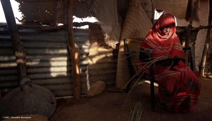 An Eritrean woman weaves grass baskets