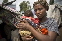 A survivor of sexual violence in conflict in the Democratic Republic of Congo with her baby. Photo: Jake Lyell  / CARE