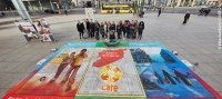 CARE staff, refugees and school children in Berlin with a street painting created to highlight the Syria crisis