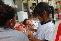 Machala Ecuador: domestic workers are often primary care givers to children.