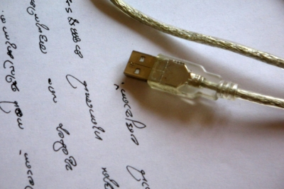 Blogging will enable us to connect better with the people we want to reach in our areas of expertise. Photo: handwriting and a usb cable