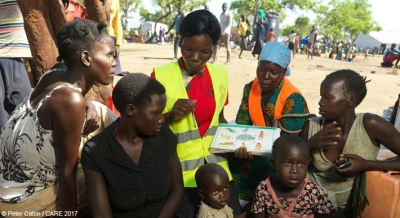 Mary, a CARE midwife, talks to refugees from South Sudan at Imvepi settlement, Uganda