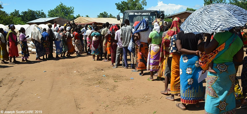 People queuing to receive water and hygiene items from CARE at a camp for flood-displaced people in Nsanje, Malawi