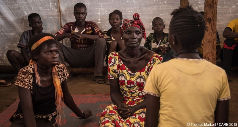Refugees from the DRC rehearsing a play about GBV in CARE's psychosocial support centre at a refugee camp in Uganda