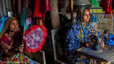 Asiya (right) has revived her dressmaking business thanks to a loan from her village savings group (Bangladesh, 2013)
