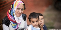 Syrian refugee Dana (not her real name) and her sons in Serbia