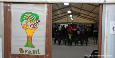 Syrian refugees watching the World Cup in CARE's Community Centre in Azraq Camp, Jordan