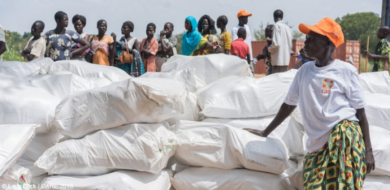 Residents of Torit, Eastern Equatoria, South Sudan wait in line to receive relief items