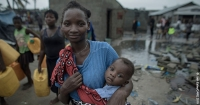 Enia Joao with her youngest child after Cyclone Idai hit the coast of Mozambique in March 2019