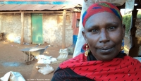 The Chairlady of a Kenyan community Savings and Loan group