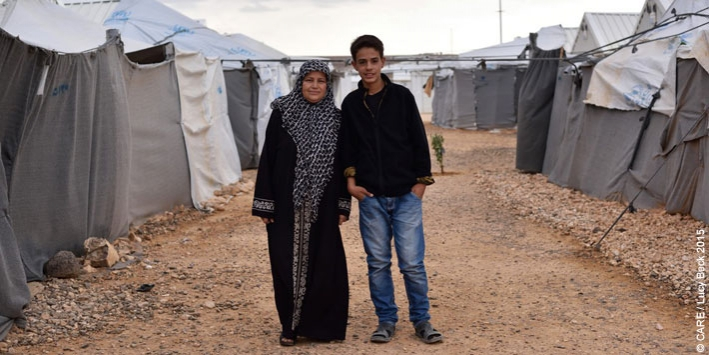45-year-old Basema, pictured with her son Hussam, lives in Azraq refugee camp in Jordan with two of her sons. Her other two sons and her husband are in Germany and Turkey.