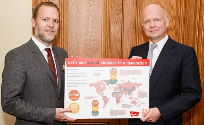 CARE International UK chief executive Laurie Lee presents the CARE petition to William Hague