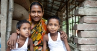 Nargis Pavin, who worked in a factory in India, with two of her children in Botospur, Bangladesh