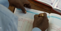 Record-keeping at the weekly meeting of the Village Savings and Loan group in Kawete, Uganda