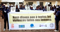 Young men participating in a march against gender-based violence during the '16 Days of Activism against GBV' campaign in the DRC, December 2014