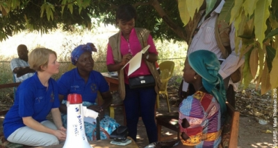 CARE staff interviewing a recipient to ensure transparency in distributing cash payments to displaced people returning to Chad