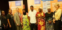 VSLA members, NMB and CARE staff pose for the press at the Pamoja Account launch in Dar es Salaam, Tanzania