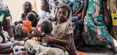 A girl and her sister wait for food supplements at a CARE-run health centre in Chad