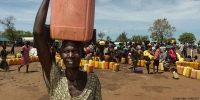 A South Sudanese refugee collects water at a camp in Uganda