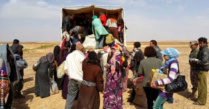 Syrian refugees being transferred from the Syrian-Jordanian border